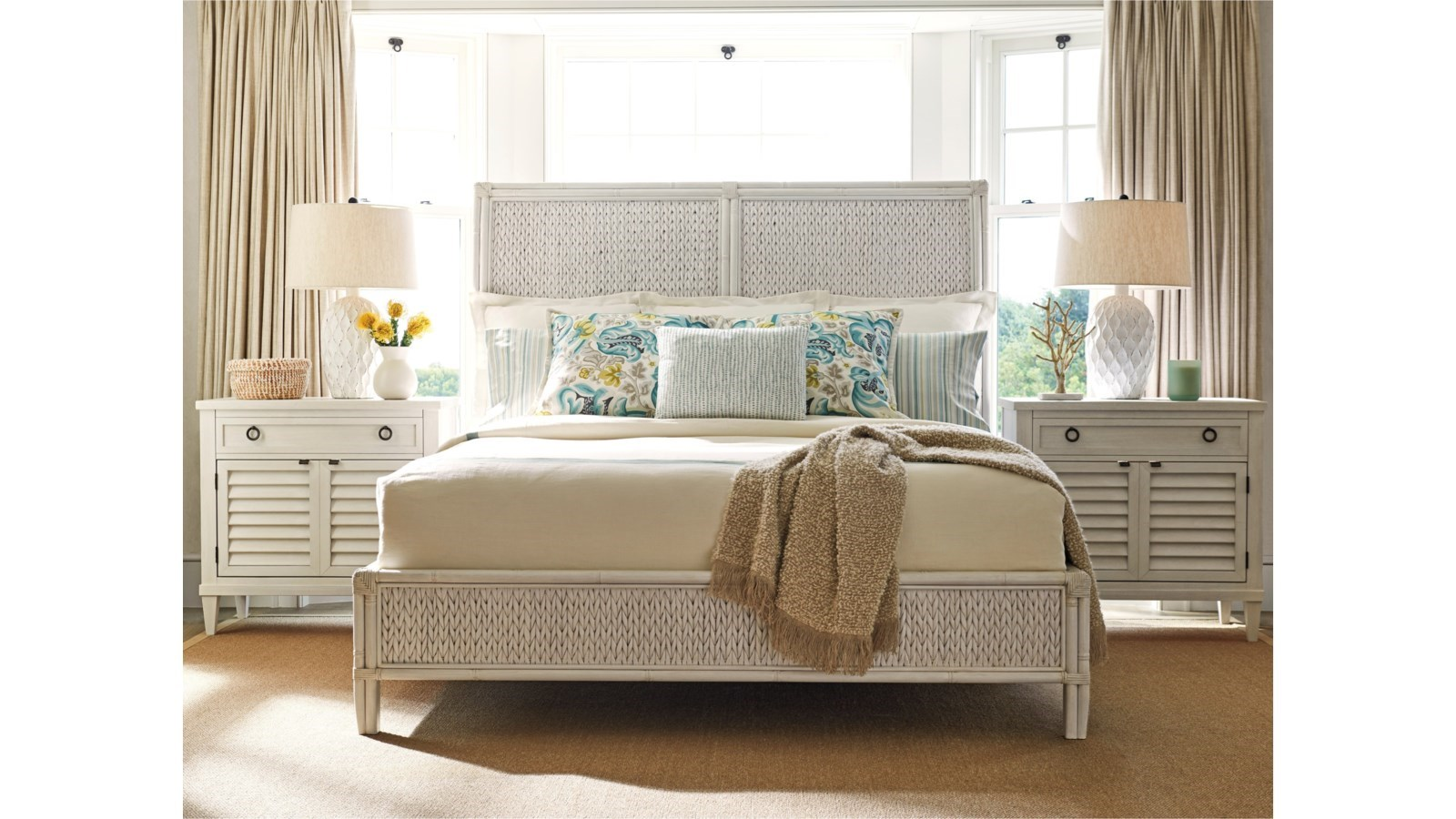 bedroom with white natural bed frame and white nightstand