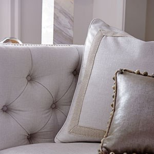 Close up of white pillows on a sofa