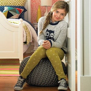 girl sitting on pouf