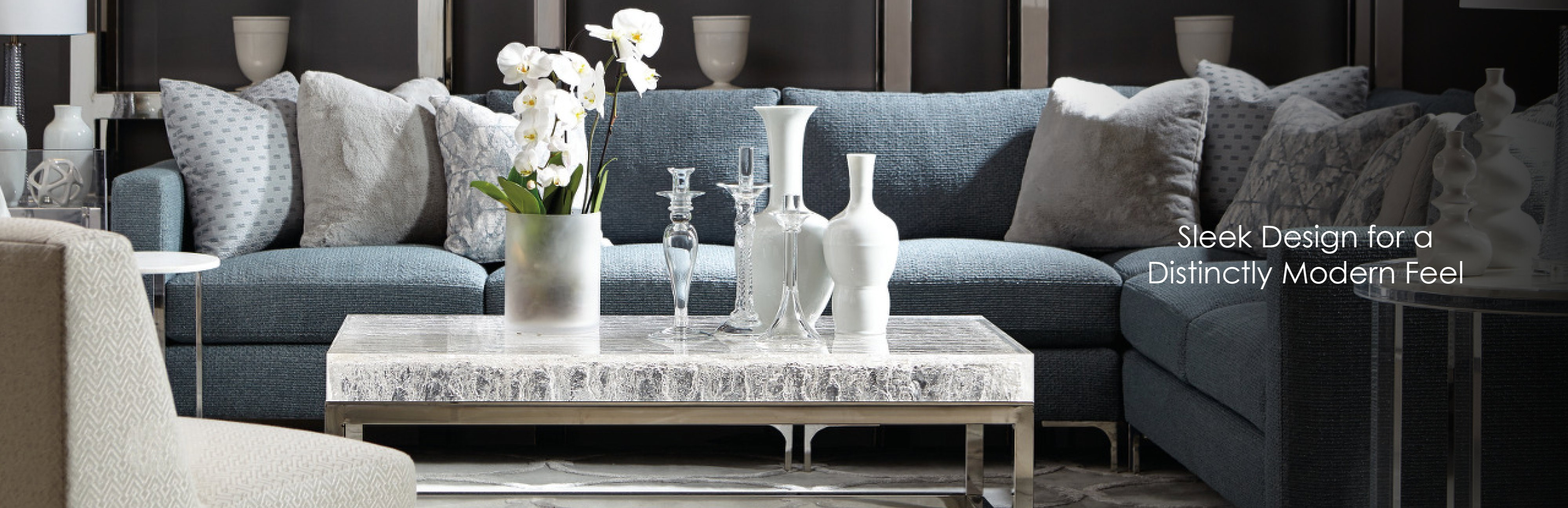 Blue sectional and marble cocktail table