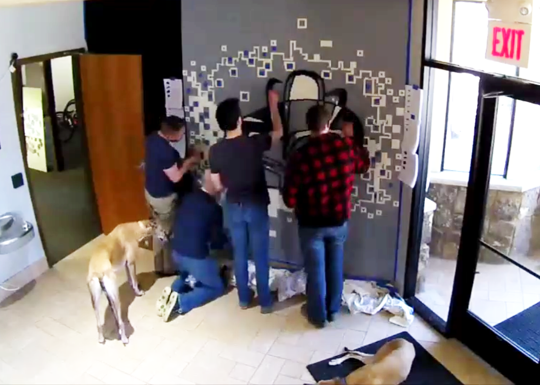 team working on the wall