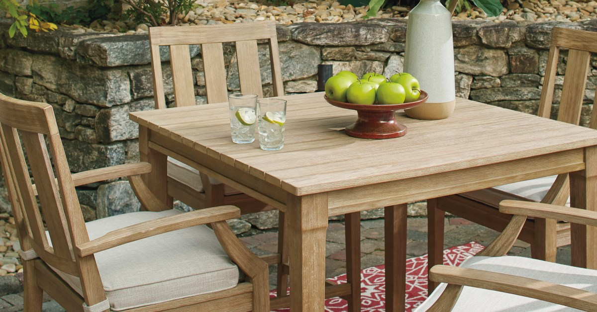 outdoor wood table with glasses