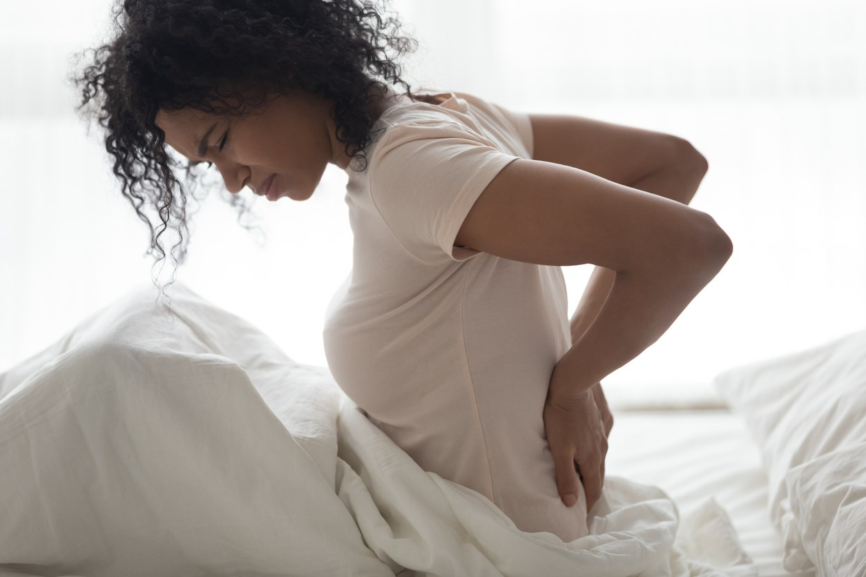lady waking up with back pain