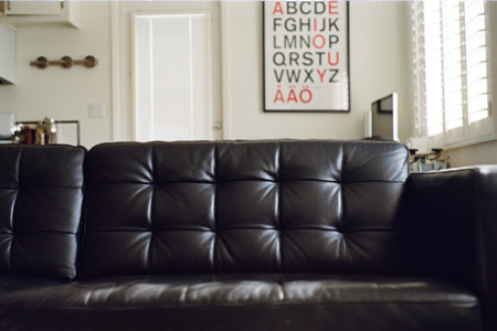 tufted black leather sofa