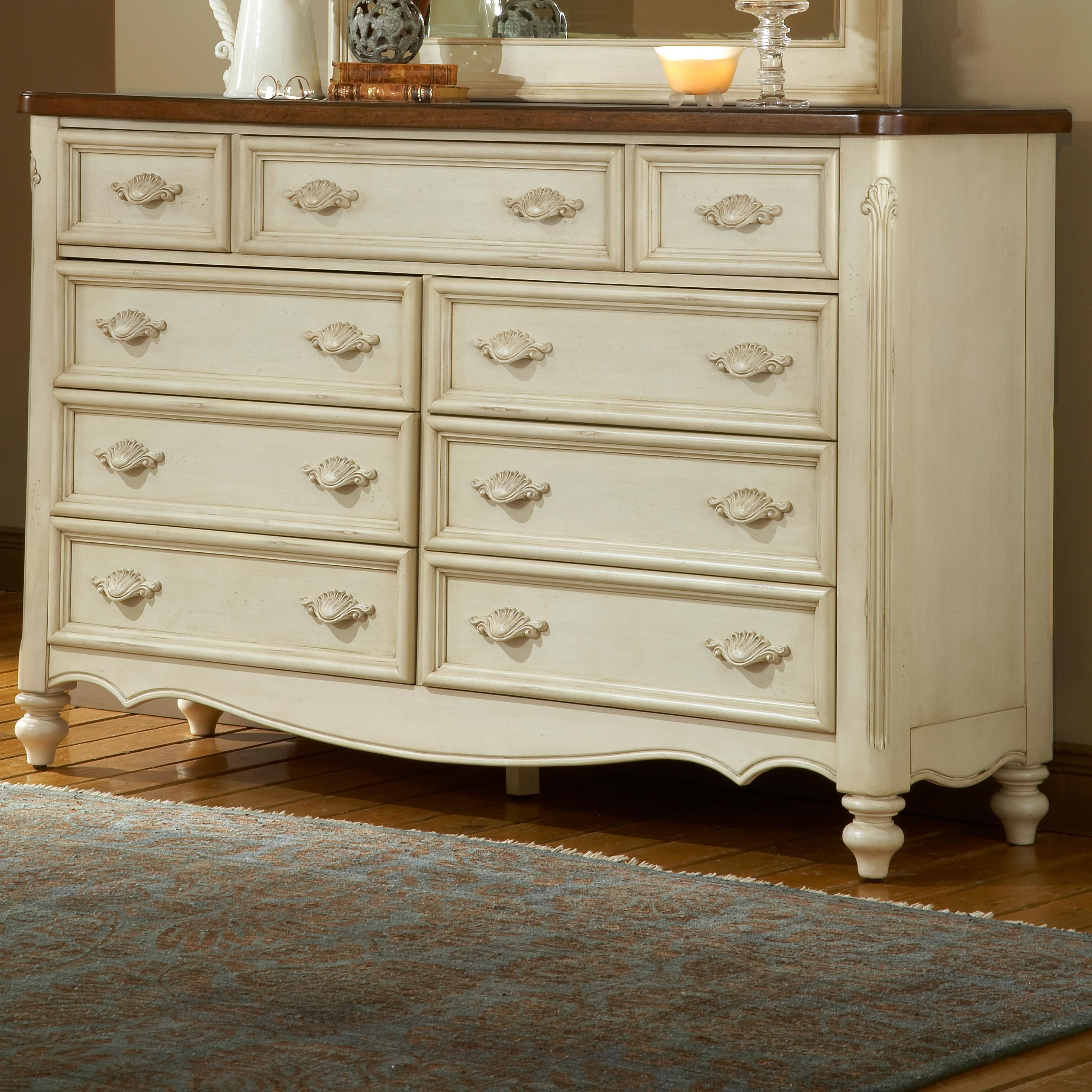 American Woodcrafters Chateau Nine Drawer Triple Front