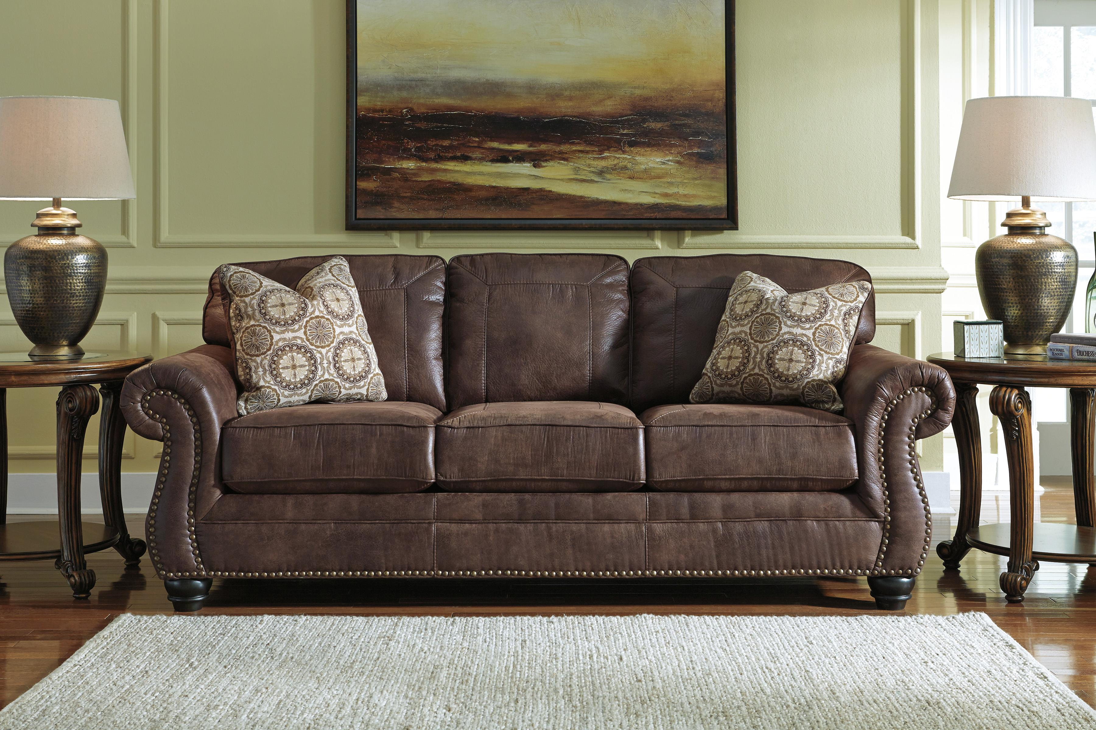 Benchcraft Breville Faux Leather Sofa With Rolled Arms And Nailhead Trim Miskelly Furniture