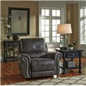 Ashley/Benchcraft Breville Faux Leather Rocker Recliner with Rolled Arms and Nailhead Trim