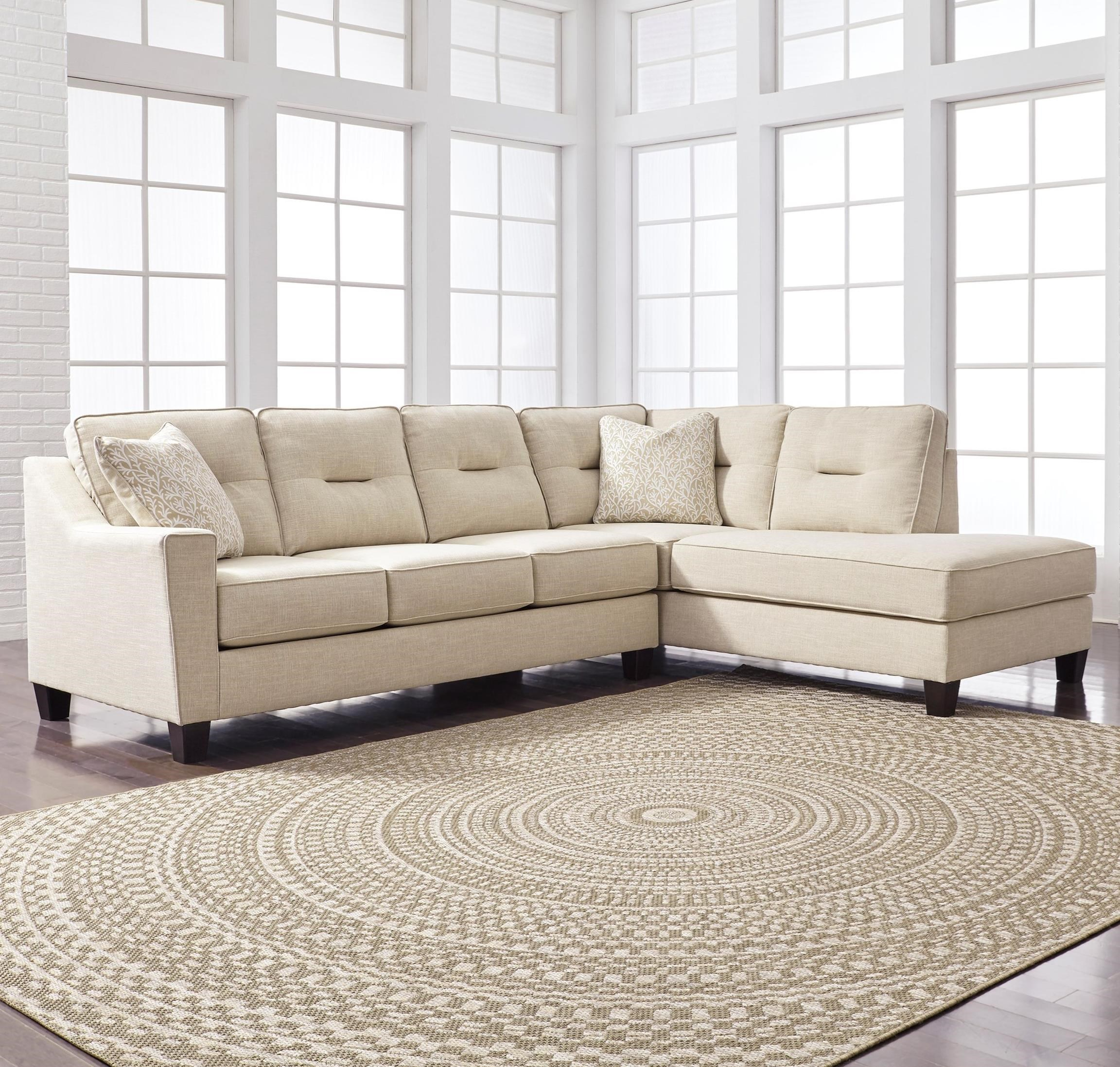 benchcraft kirwin nuvella sectional with sleeper sofa right
