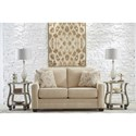Benchcraft Mauricio Loveseat with Coil Seat Cushions & Track Arms with Nailheads