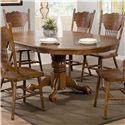 Coaster Brooks Oak Finish Round/Oval Dining Table with Single Pedestal & Decorative Apron - 104270