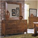 Morris Home Furnishings Tuscon Mirror with Beveled Edge and Rustic Wood Frame - Shown with dresser