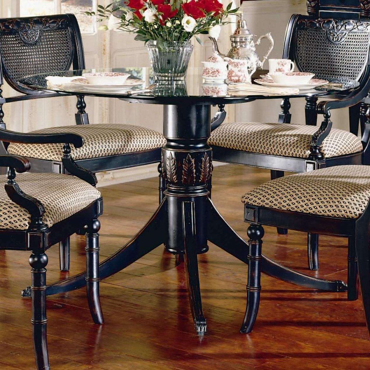 largo heritage round dining table with glass top and carved base