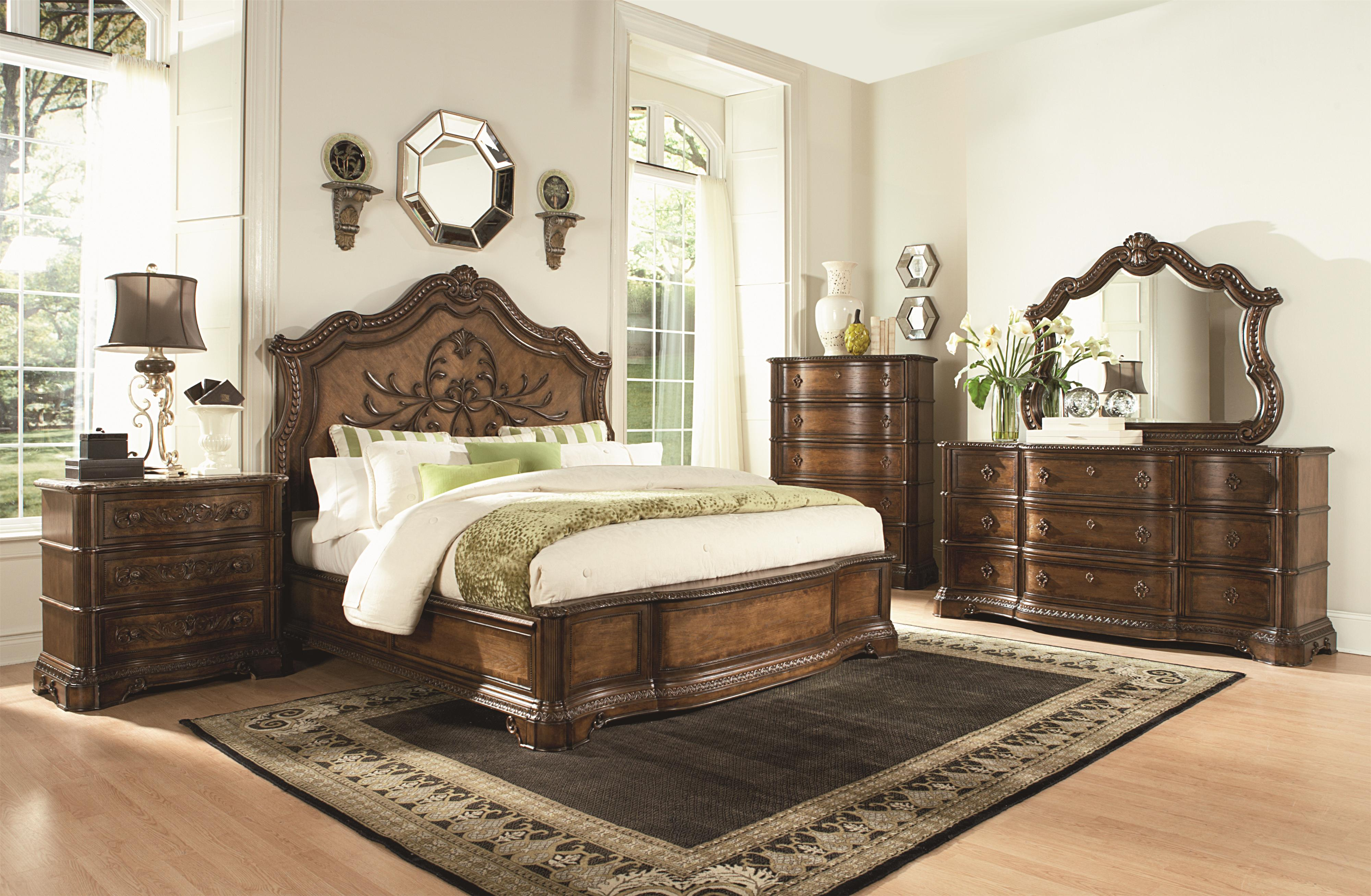 Pemberleigh king panel bed with wood carved details by for Furniture collection