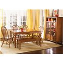 Liberty Furniture Low Country Windsor Back Side Chair with Turned Legs - Windsor Side Chair Shown in Room Setting with Rectangular Table, Bench and Curio