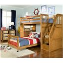 NE Kids School House Twin Stair Loft Bed w/ Lower Bed - Shown in Room Setting with Chair and Horizontal Bookcase
