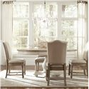 Riverside Furniture Coventry Two Tone Upholstered Side Chair with Hammered Nail Head Trim - Shown with Round Dining Table