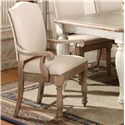 Riverside Furniture Coventry Two Tone Upholstered Arm Chair with Hammered Nail Head Trim - Shown in Dining Room