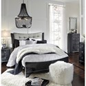 Signature Design by Ashley Amrothi Queen Upholstered Panel Bed with Silver Finish Faux Leather