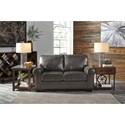 Signature Design by Ashley Canterelli Leather Match Loveseat with Rolled Arms