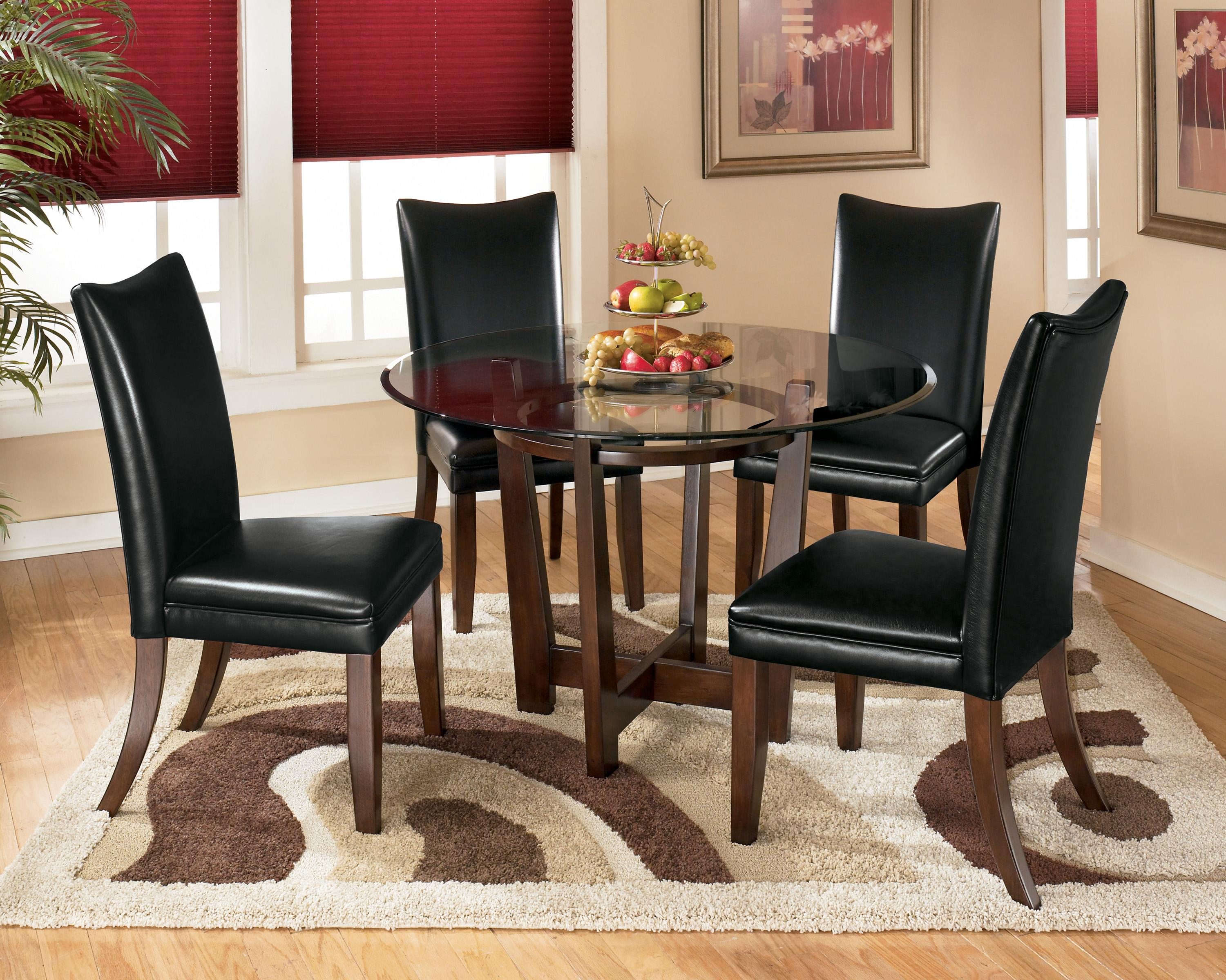 Charrell 5 Piece Round Dining Table Set with Black Chairs by Ashley  Signature Design at Dunk & Bright Furniture
