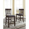 Signature Design by Ashley Haddigan Upholstered Barstool with Slat Back & Faux Leather Seat