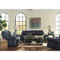 Signature Design by Ashley Milhaven Reclining Sofa with Rolled Arms & Nailhead Trim