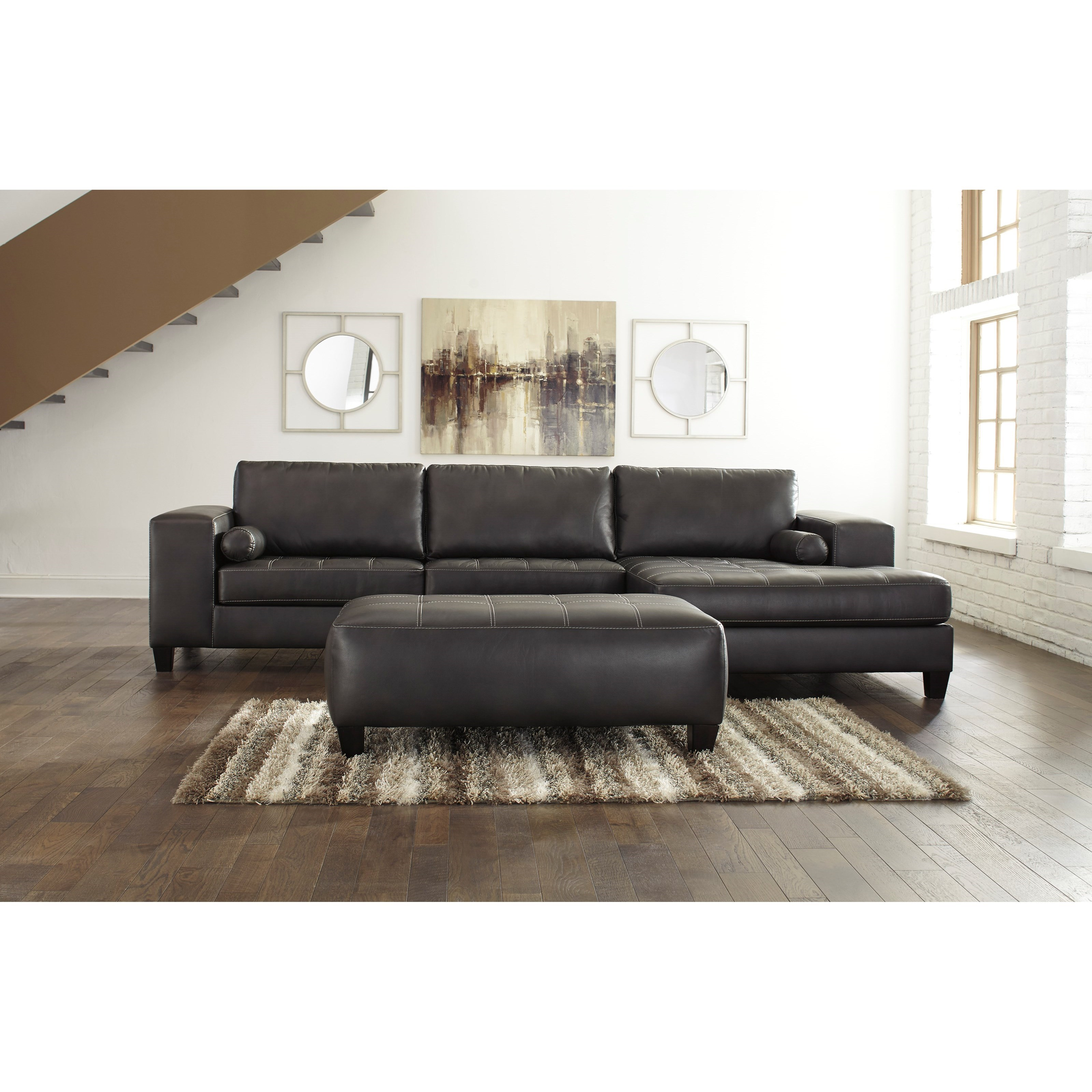 Ashley signature design nokomis contemporary faux leather for Ashley leather sectional with chaise