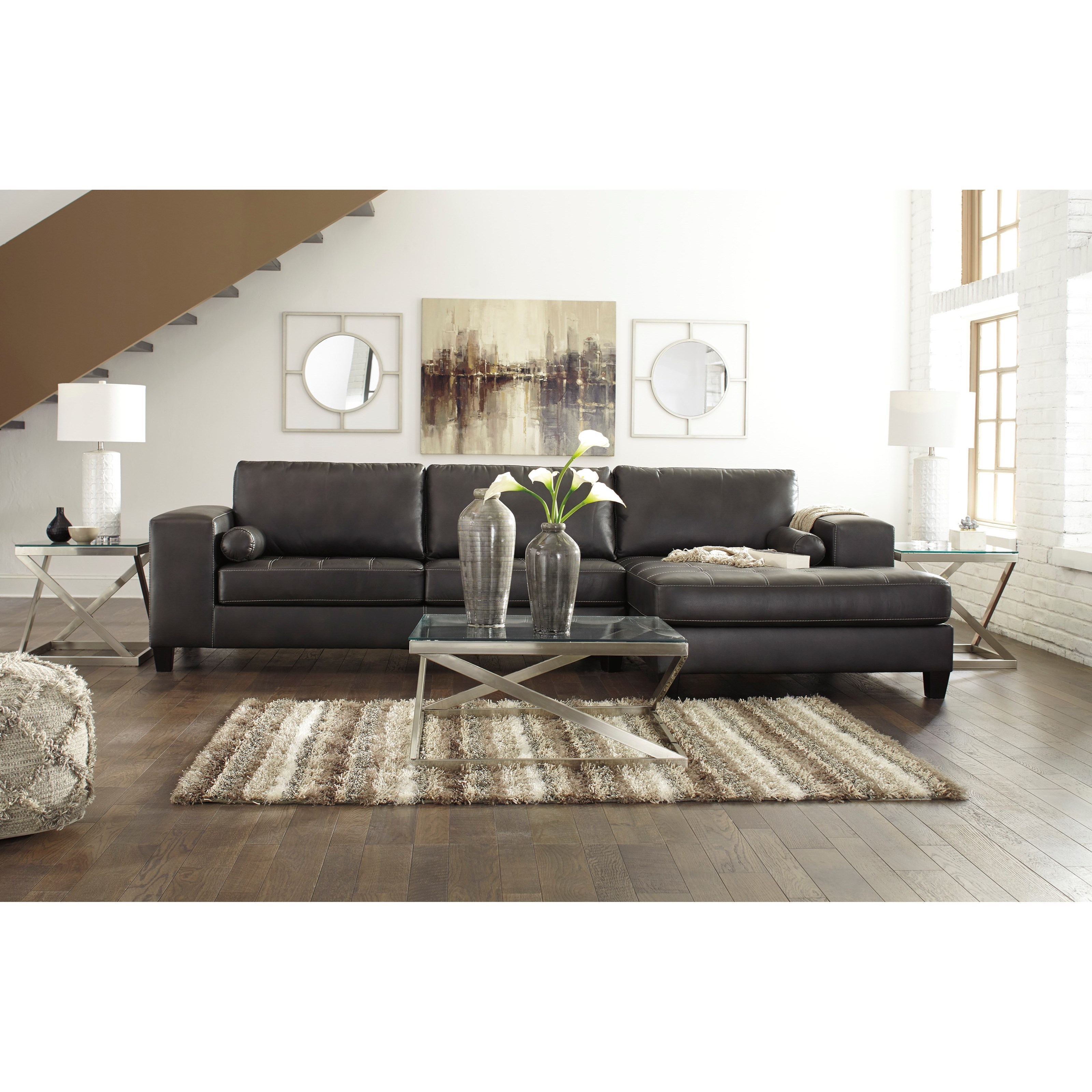 Ashley signature design nokomis contemporary faux leather for Ashley sectional sofa with chaise