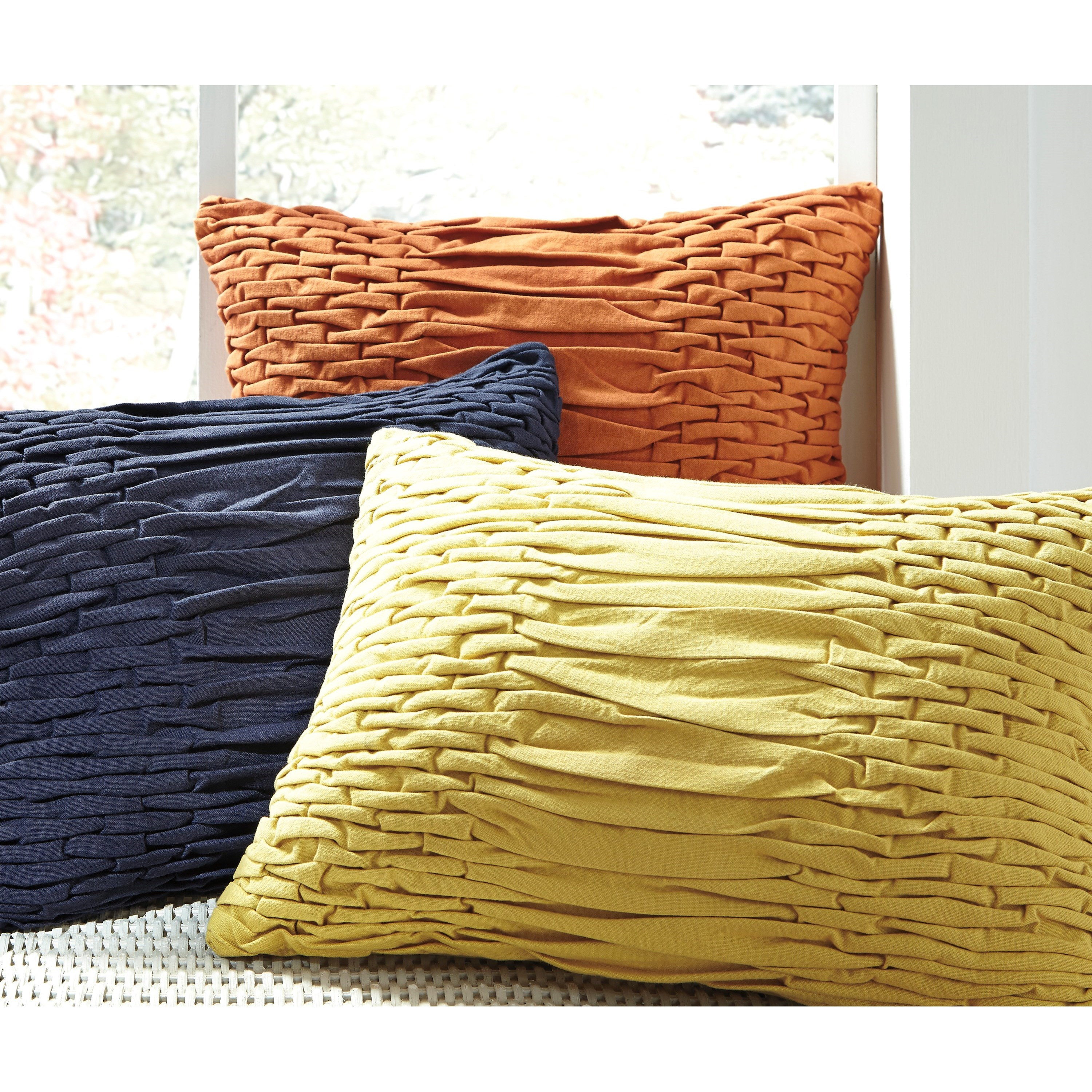 Signature Design by Ashley Pillows Nellie Coral Pillow - Olindeu0026#39;s Furniture - Throw Pillows