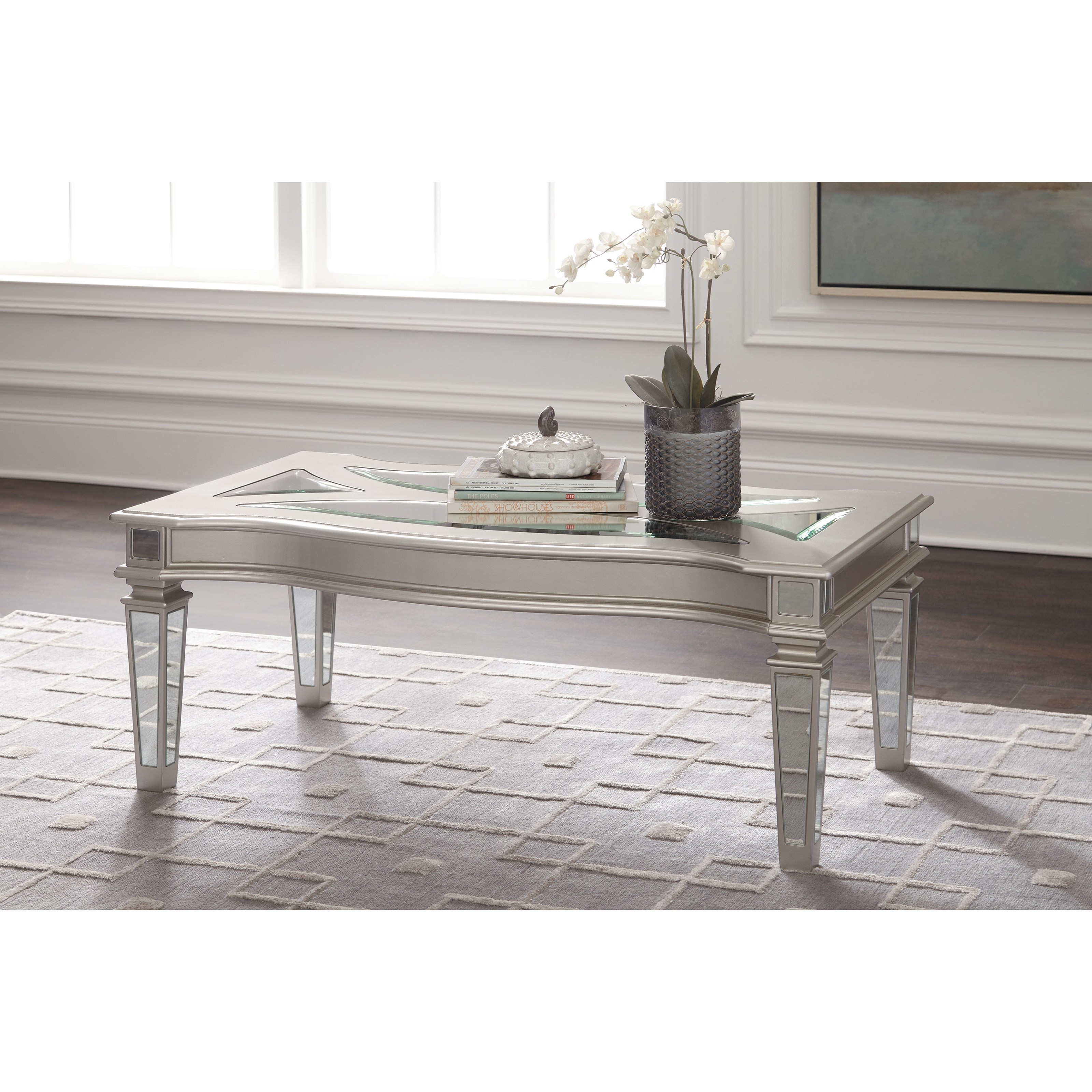 Signature Design By Ashley Tessani Silver Finish Rectangular Cocktail Table With Mirror Panels