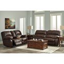 Signature Design by Ashley Zavier Glider Reclining Loveseat w/ Console in Faux Brown Leather