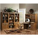 Sunny Designs Sedona Rustic Oak Computer Desk - Shown with desk chair and bookcase wall unit