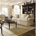 Thomasville® Fredericksburg Oval Cocktail Table with Turned Detail  - Shown with an Upholstered Sofa and Bibliotheque Bookcase