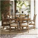 Tommy Bahama Home Beach House <b>Customizable</b> Sanibel Arm Chair with Leather-Wrapped Bent Rattan Back - Shown with Coconut Grove Dining Table and Sanibel Side Chairs