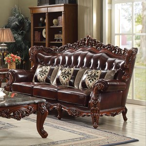 Ornately Carved Traditional Sofa with Exposed Wood Wing Back and Tufted Leather