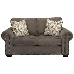 Transitional Loveseat with Nailhead Trim & Coil Seating