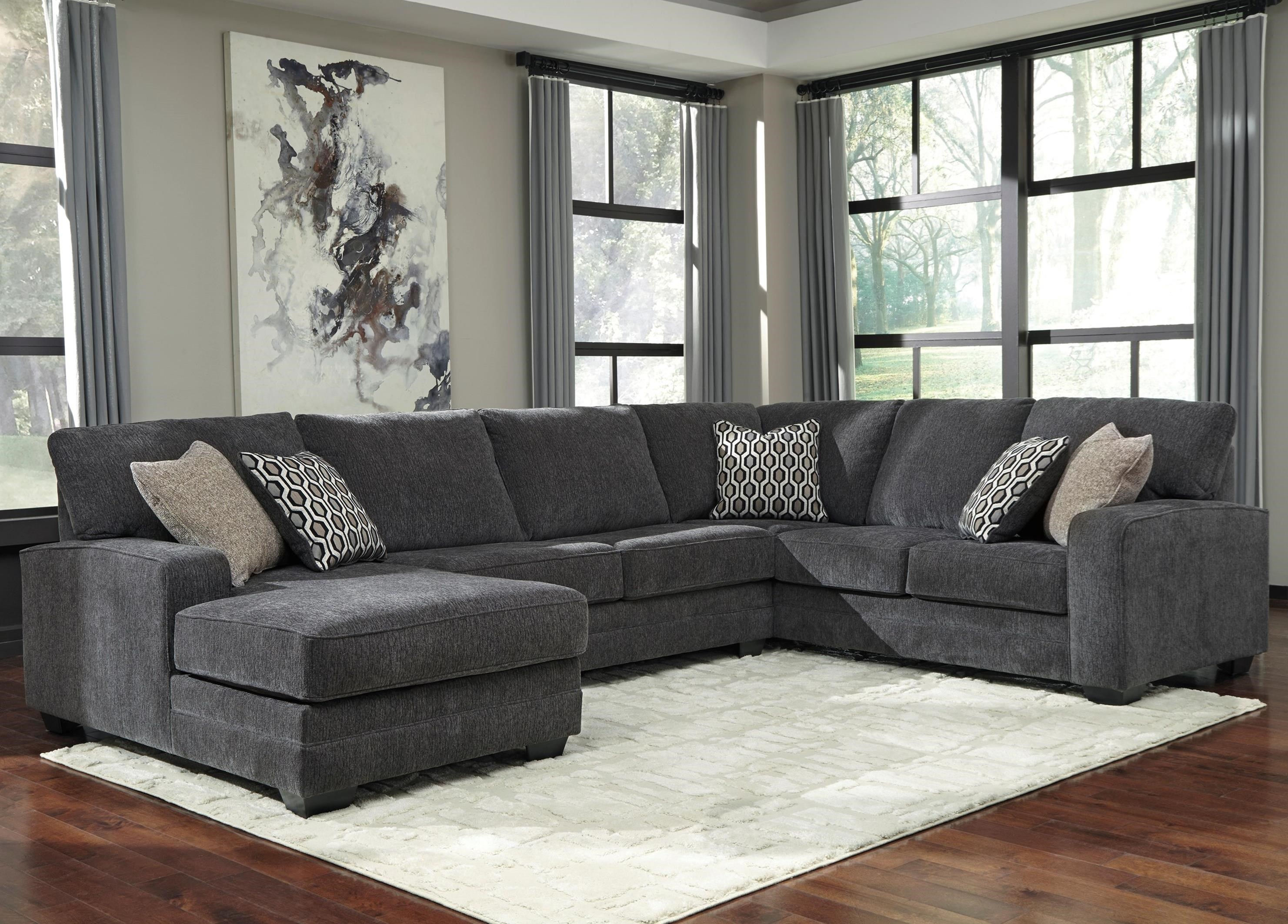 Tracling Sectional with Left Chaise by Benchcraft at Johnny Janosik