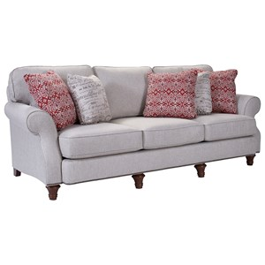 Stationary Sofa with Rolled Arms, Turned Wood Legs, and Nail Head Trim