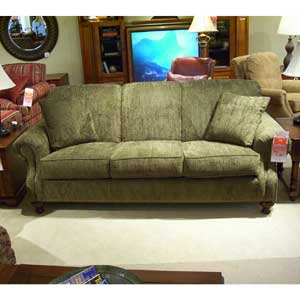 Rolled arm and back sofa with nail head trim