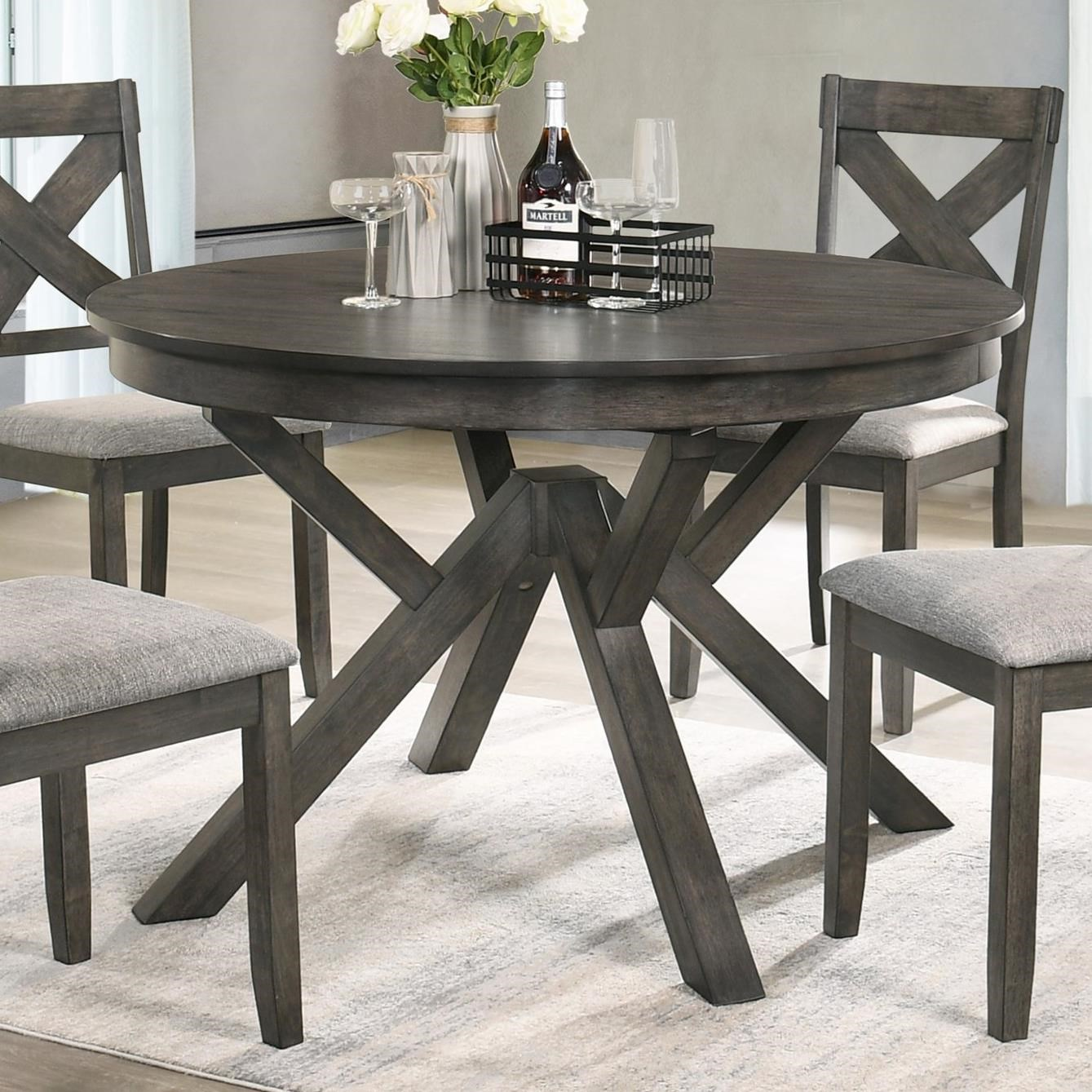 Gulliver Round Dining Table by New Classic at Rife's Home Furniture