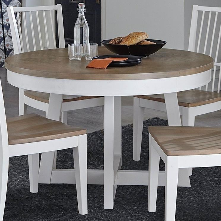 Americana Modern Dining Table 48 in. Round to 66 in. by Parker House at Furniture and ApplianceMart