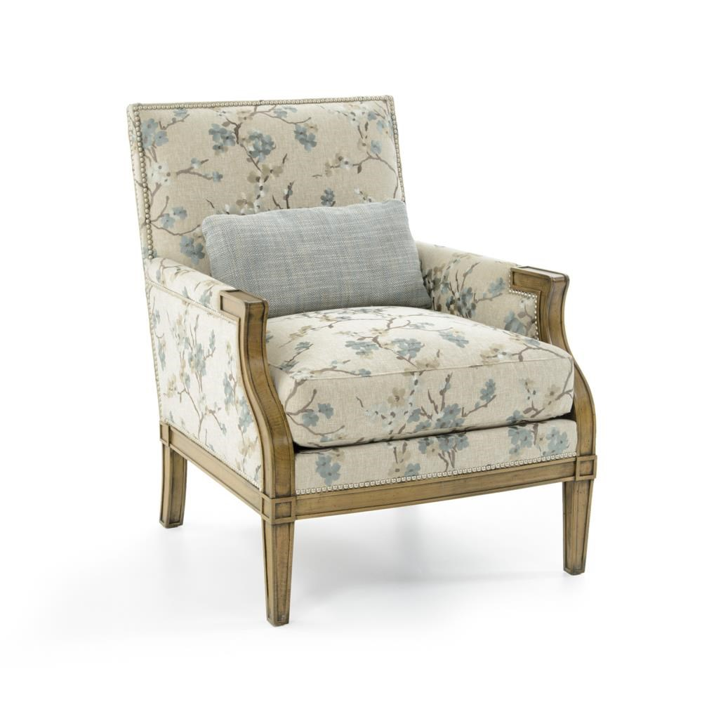Upholstered Chair with Carved Wood Detail and Nails