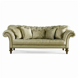 Fully Tufted Sofa with Nailhead Trim and Turned Wood Legs