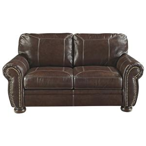 Traditional Leather Match Loveseat with Rolled Arms, Nailhead Trim, & Bun Feet