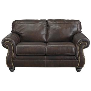 Traditional Leather Match Loveseat with Rolled Arms & Nailhead Trim