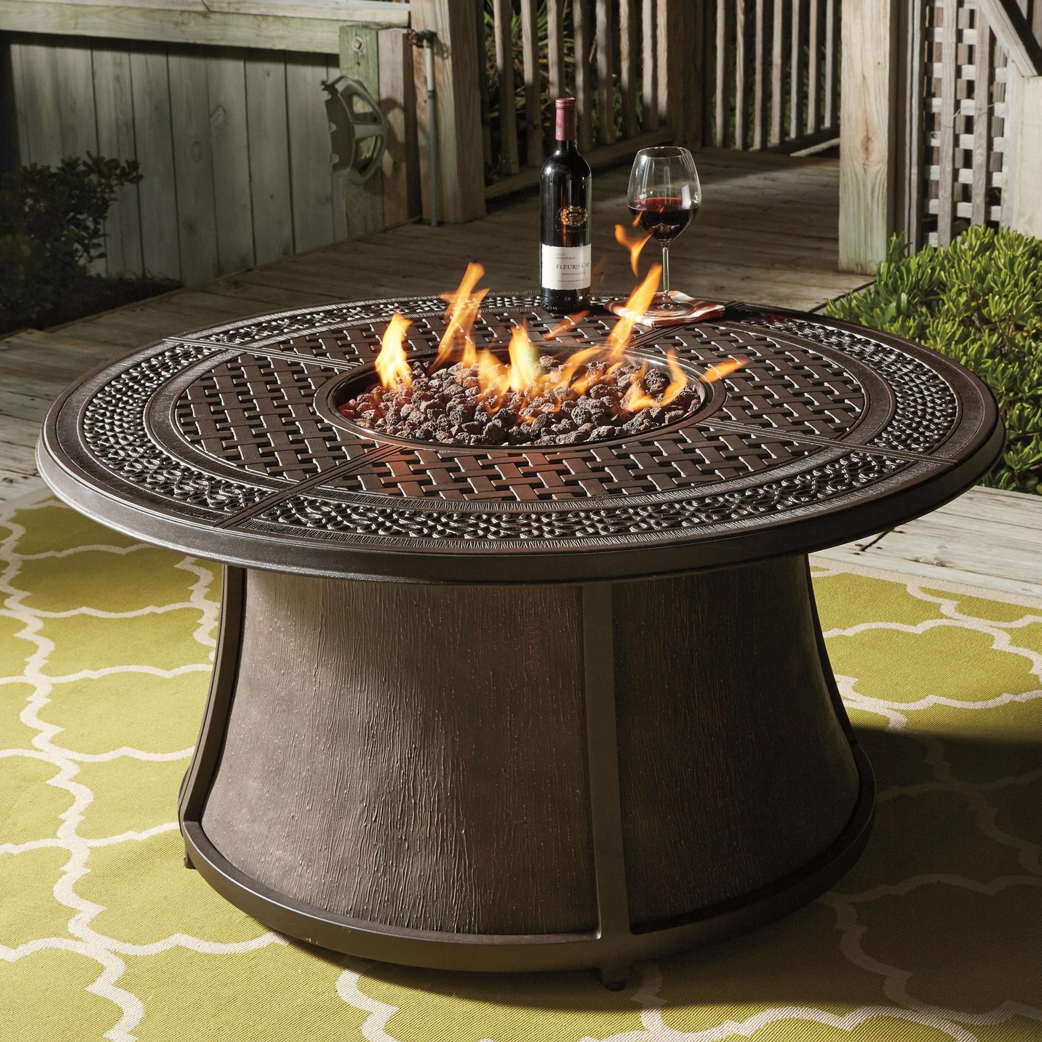Burnella Outdoor Round Fire Pit Table by Signature Design by Ashley at Lapeer Furniture & Mattress Center