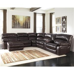 Signature Design by Ashley Damacio - Dark Brown Rec Sectional w/ Console & Press Back Chaise