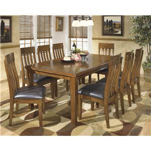 Casual 9-Piece Dining Set with Butterfly Extension Leaf