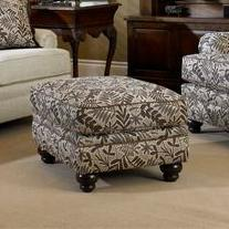 Upholstered Ottoman with Turned Leg