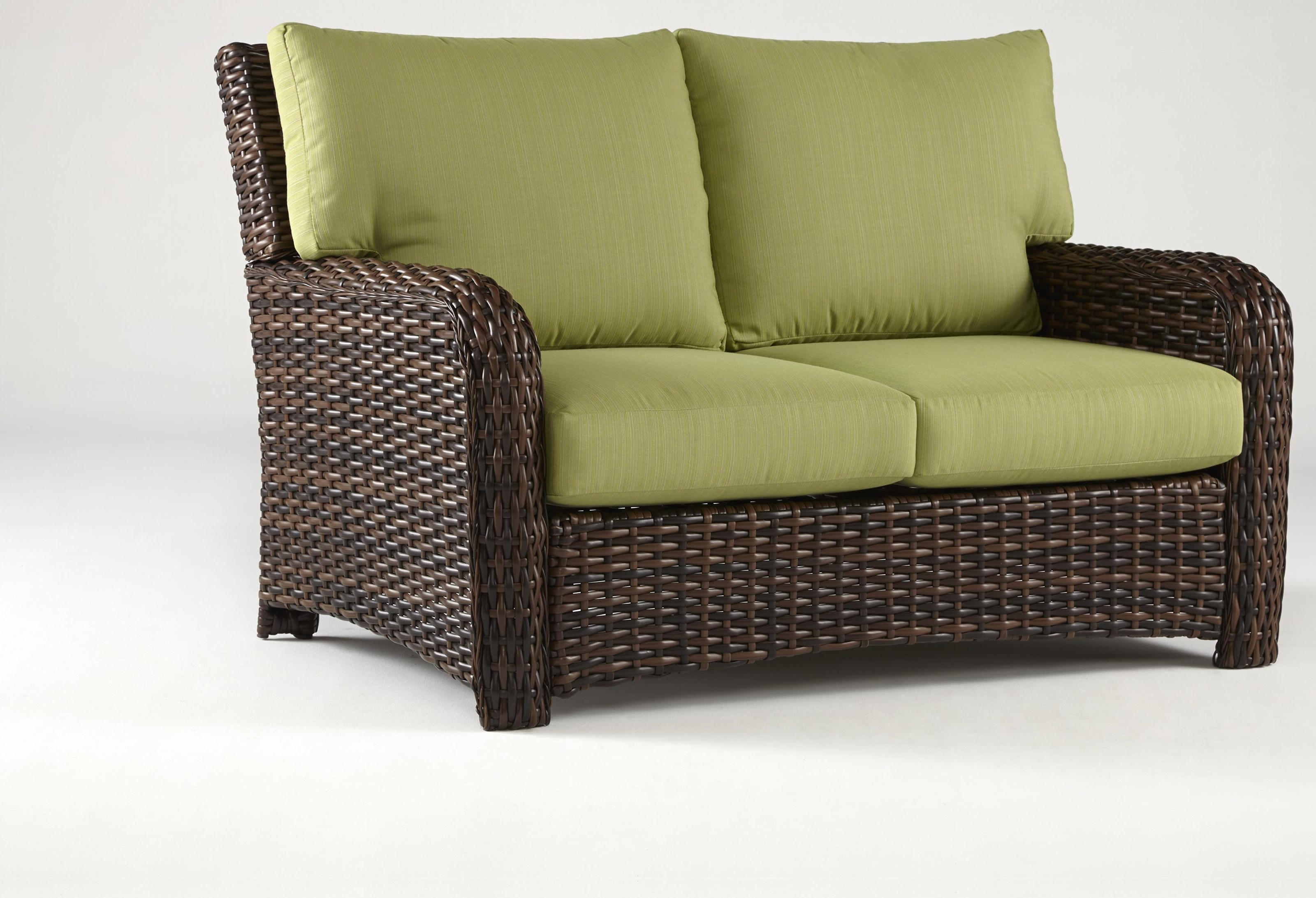 Saint Tropez Loveseat with Luxterior Cushion by South Sea Rattan & Wicker at Johnny Janosik